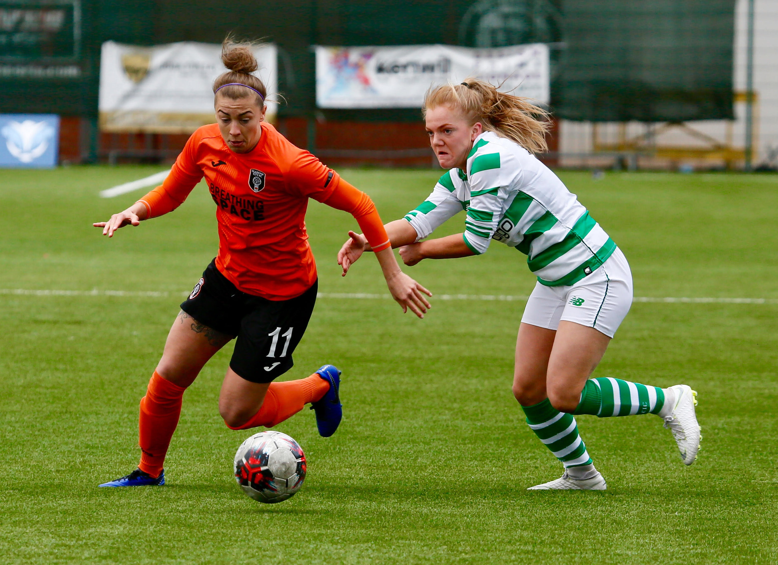 City's Nicola Docherty skips past Celtic's Kodie Hay. (image by Andy Buist