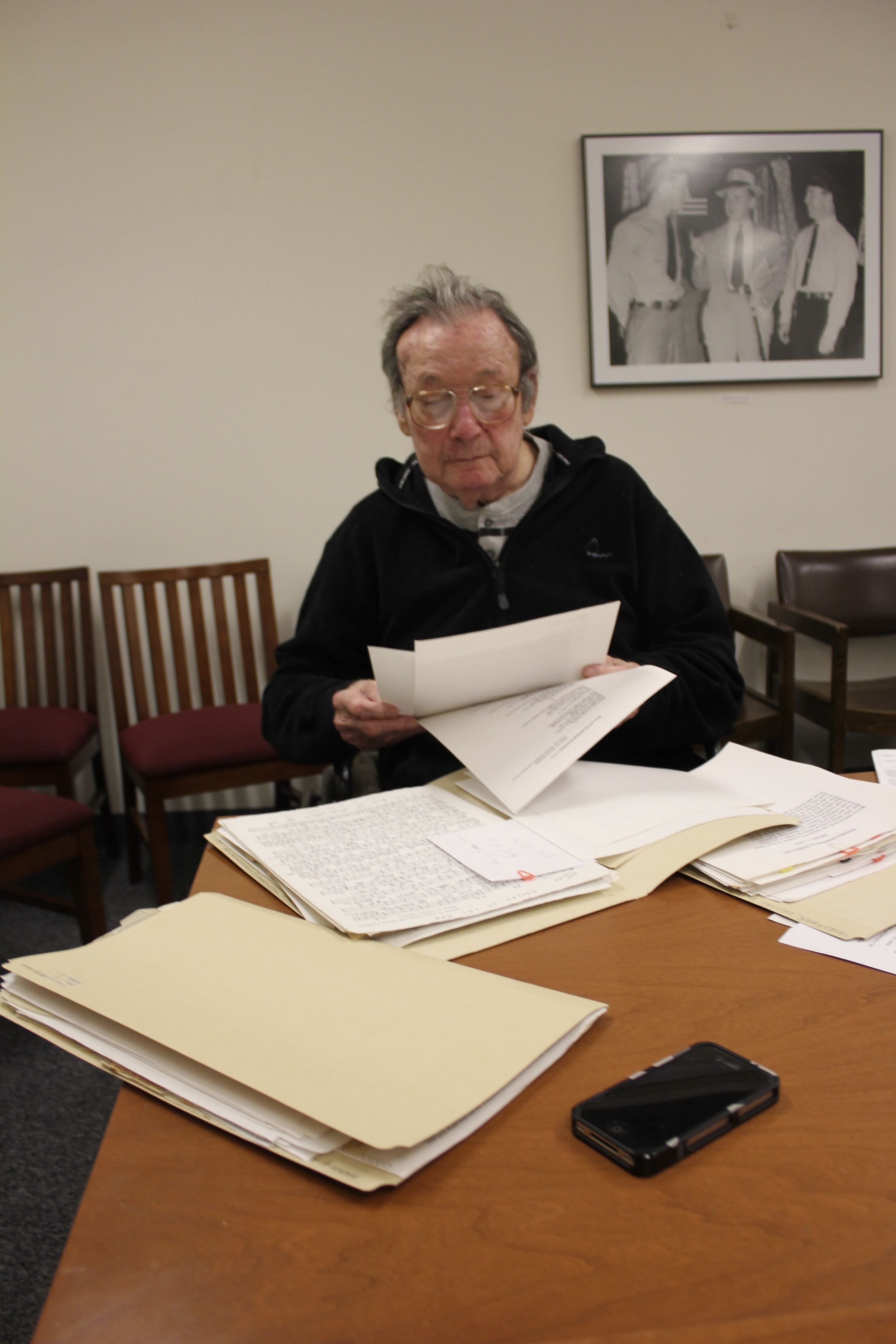 Henry Foner examines his collected papers. Bobst Library, New York University (NYU) Campus.