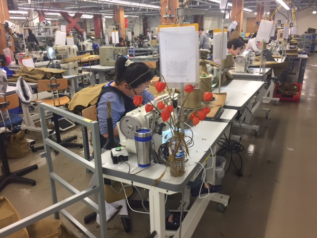 I love the splash of floral color amidst the otherwise industrial sewing stations.