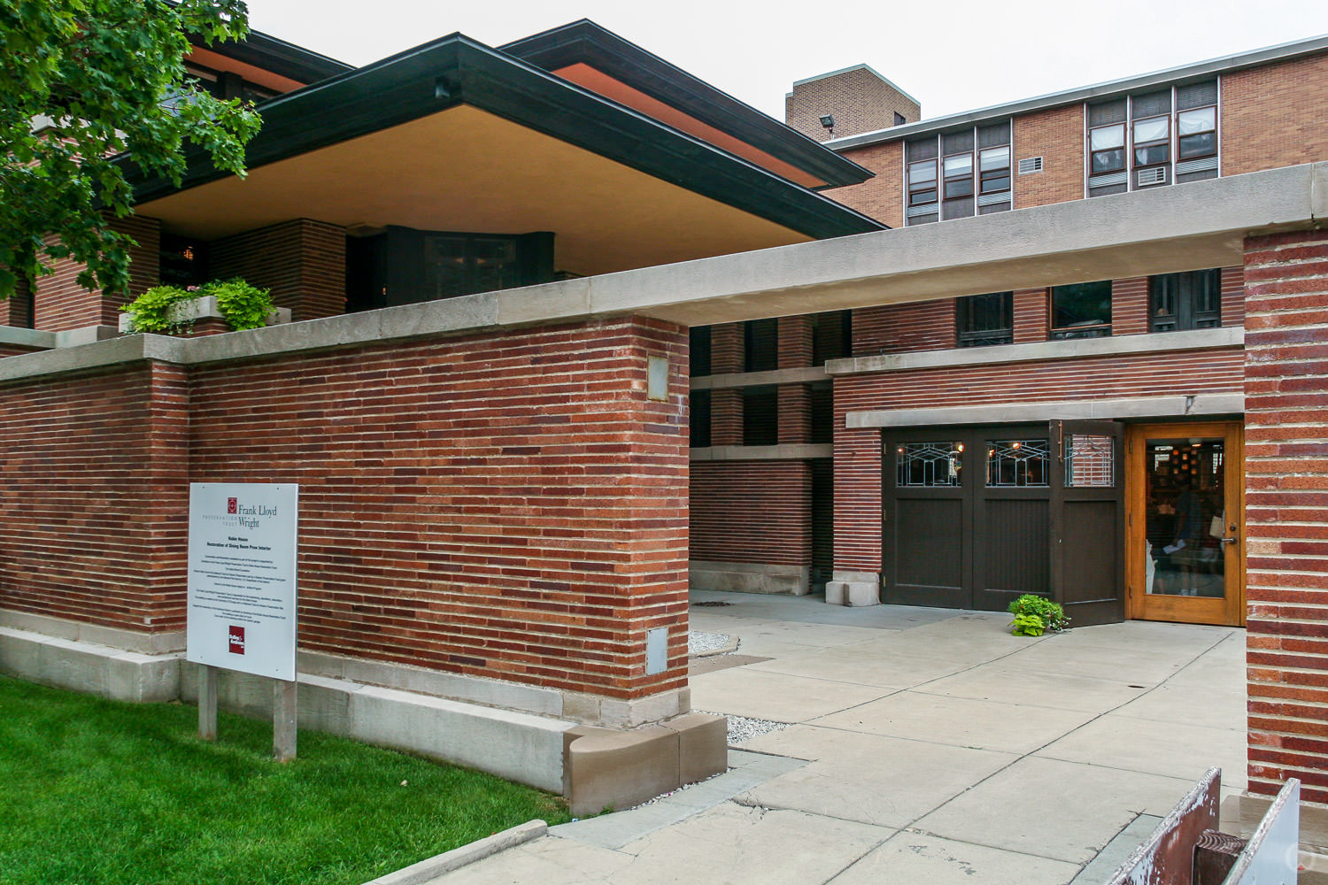 The motor court (off E. 58th St.) serves as the main entry for  tours . The garage now houses the front office and  gift shop.