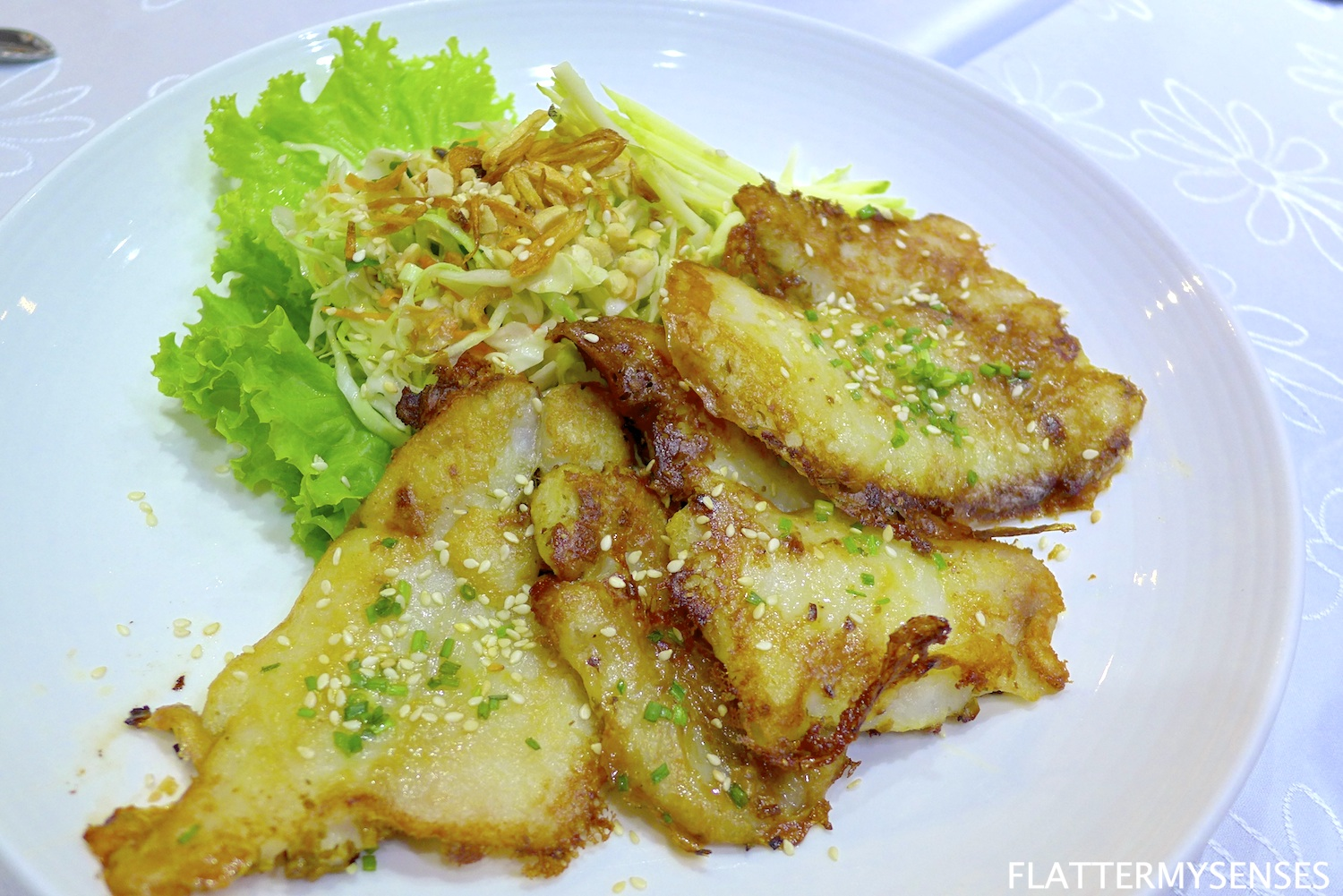 Ca Nuong Xa Ot  ( Php 385 ) pan-fried lemongrass Dory fillet, served with a side of green mango chicken salad.