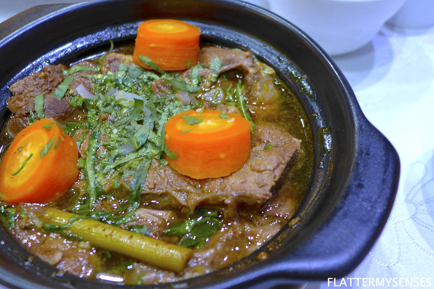 Bo Kho  ( Php 355 ) 12-spice slow-cooked beef stew with fried potatoes, carrots and lemongrass, served with either a side of rice or flat noodles.