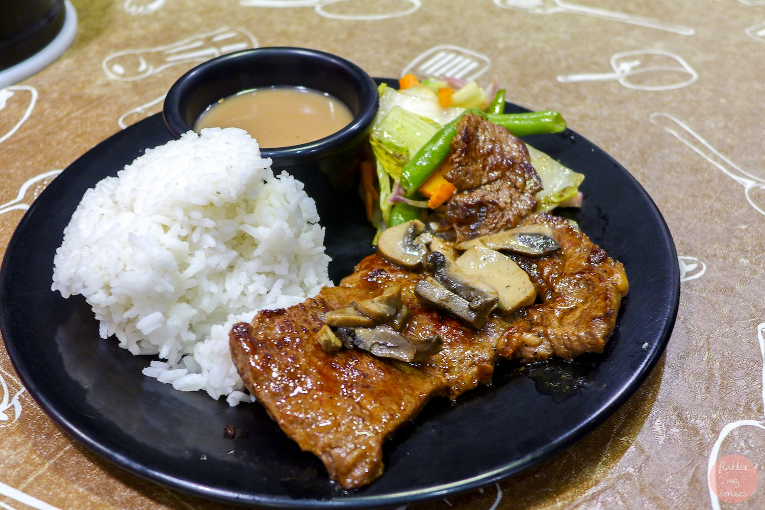 Solo Steak (Php 199). Our signature US Rib-Eye and Rice served with Gravy or BBQ Sauce
