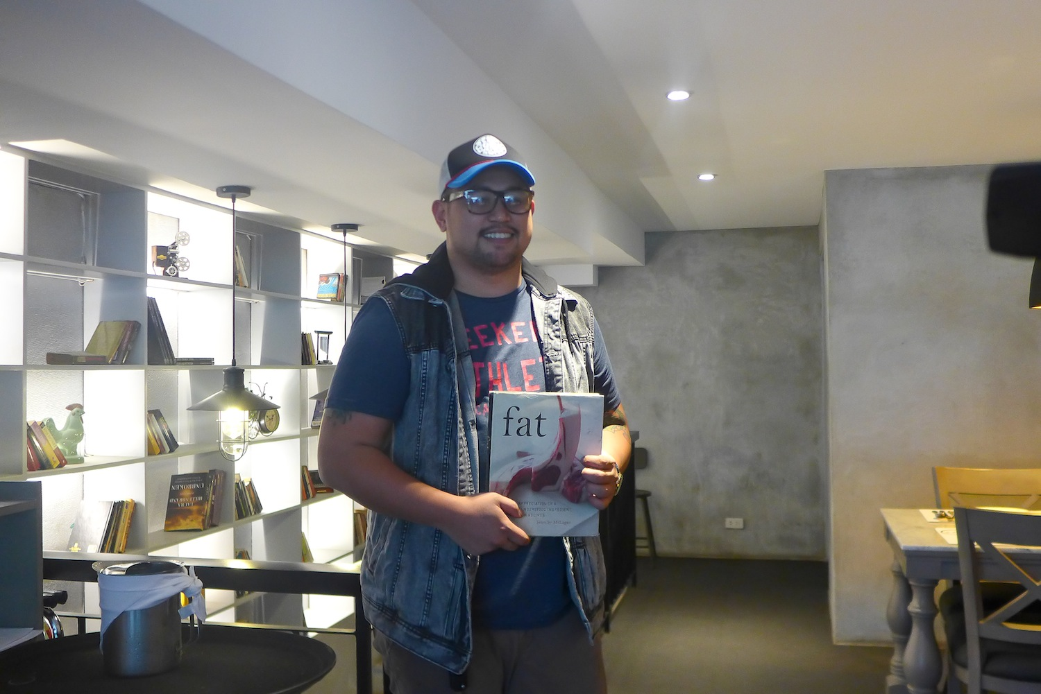 Chef Kel Zaguirre holding the coffee-table book that sparked it all.