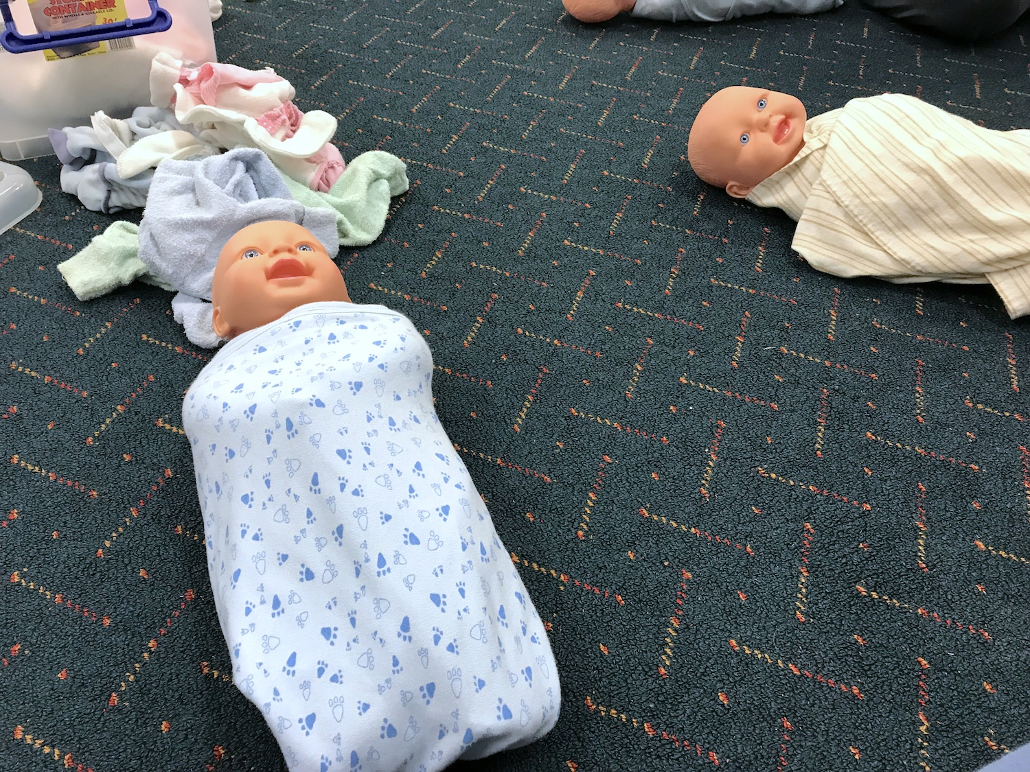 Masters in swaddling... baby dolls!