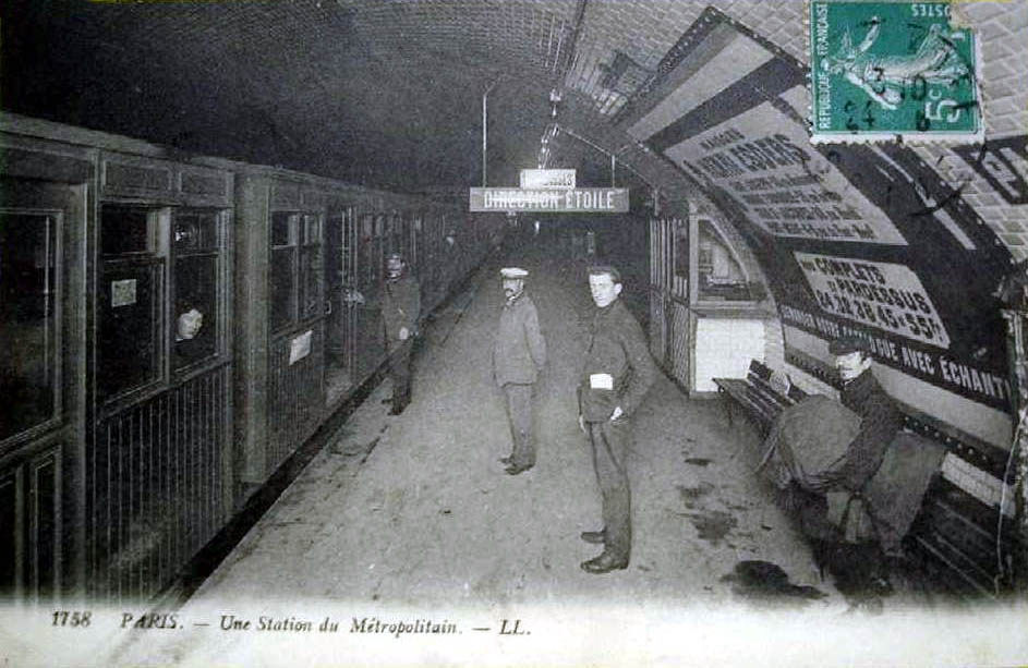 """from    https://en.wikipedia.org/wiki/Architecture_of_the_Paris_M%C3%A9tro     """"This postcard of line 6's Pasteur station in the first decade of the métro's operation shows how insufficient the lighting was. The famous beveled white tile is nevertheless clearly visible."""""""