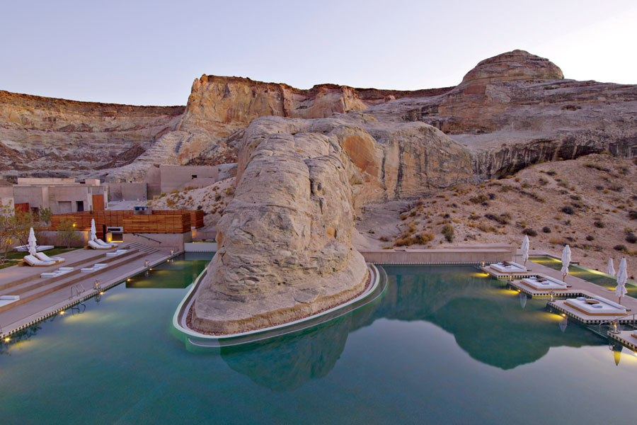 AMANGIRI CANYON POINT, UTAH  Tucked within a remote valley in the middle of the Four Corners—the area of the Southwest where Utah, Colorado, New Mexico, and Arizona all meet—the three-year-old Amangiri resort was designed to blend seamlessly into its breathtaking desert surroundings. Created by Adrian Zecha in collaboration with architects Marwan Al-Sayed, Wendell Burnette, and maestro of the desert Rick Joy, the 34-suite hotel abounds with awe-inspiring details, but perhaps the most impressive is the extraordinary swimming pool—built around a massive, 165-million-year-old Entrada sandstone rock escarpment, it snakes through the rugged terrain and is surrounded by luxurious king-size daybeds.  amanresorts.com