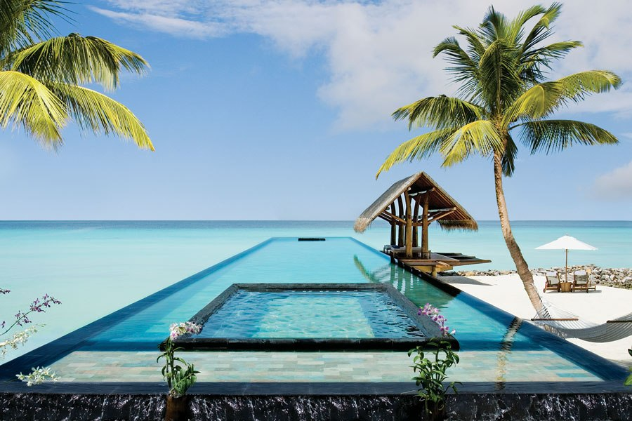 ONE&ONLY REETHI RAH NORTH MALE ATOLL, MALDIVES  Set on a private island in the middle of the Indian Ocean, this tropical paradise, which opened in 2005, consists of 130 intimate villas scattered across white-sand beaches and lushly landscaped grounds. The property showcases more than 50 different pools, including a gorgeous, adults-only lap pool that extends over 100 feet into the crystal-clear waters of a lagoon. Its carved-stone bed is the perfect place to relax and bask in the sun.  reethirah.oneandonlyresorts.com