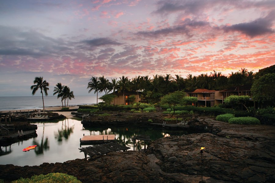 FOUR SEASONS RESORT HUALALAI AT HISTORIC KA'UPULEHU KAILUA-KONA, HAWAII  Located on the exclusive Kona-Kohala coast of Hawaii's Big Island, this 32-acre resort is dotted with picturesque guest bungalows, white-sand beaches, and a championship golf course. The property also boasts seven swimming pools, including King's Pond, a 1.8-million-gallon natural one carved out of lava, which is home to more than 3,000 tropical fish. Subterranean channels fill the pond with ocean water that ebbs and flows with the tide, and snorkeling equipment is provided to guests.  fourseasons.com
