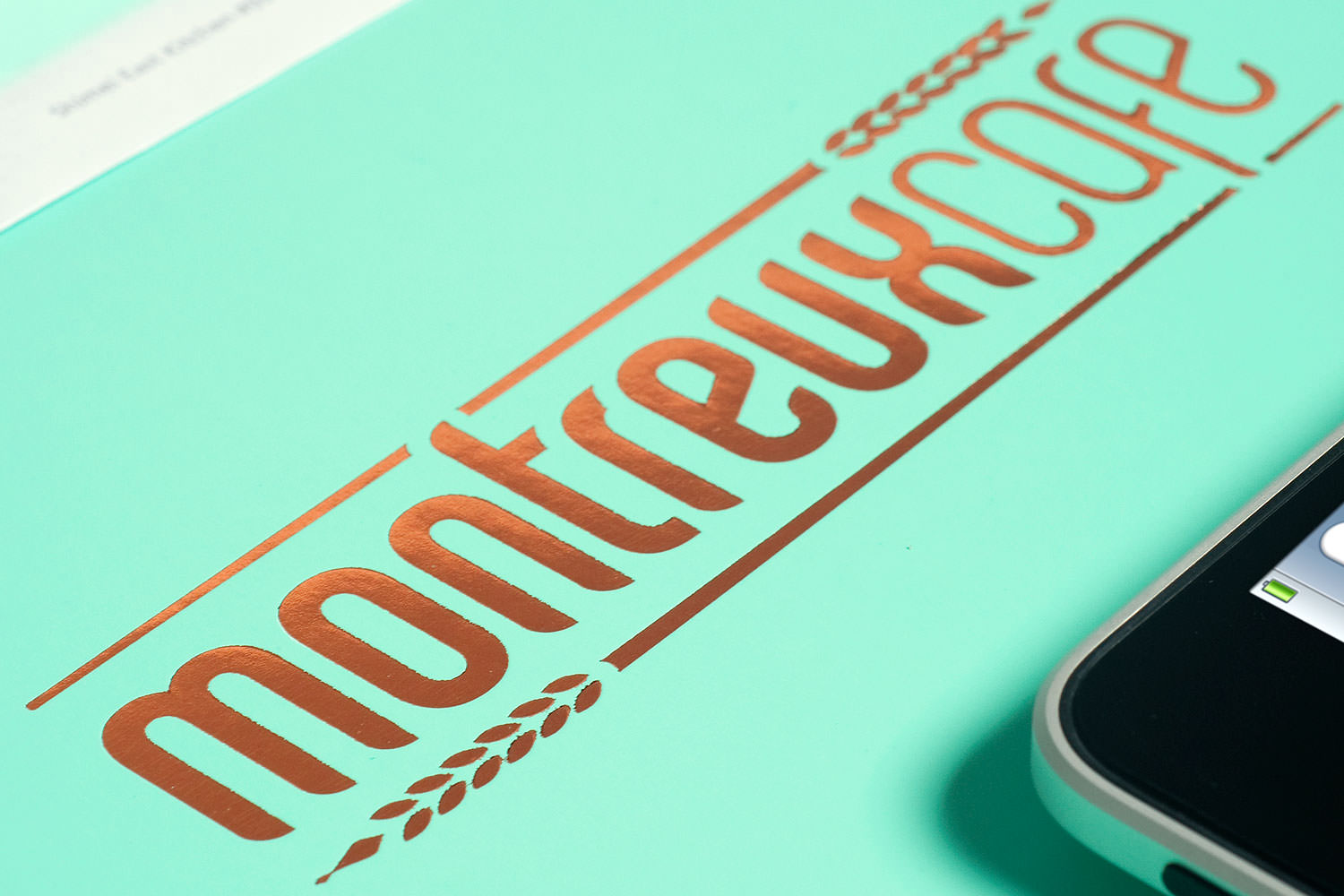 Montreux Café SG branding identity design - Foil-stamped logo on packaging.