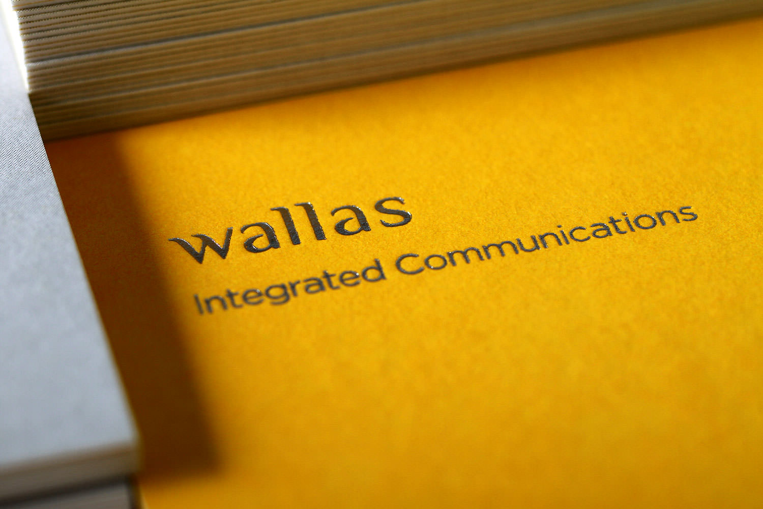 Branding identity design for Wallas Inc, an integrated agency in SG - Foil-stamped logo on Business cards.