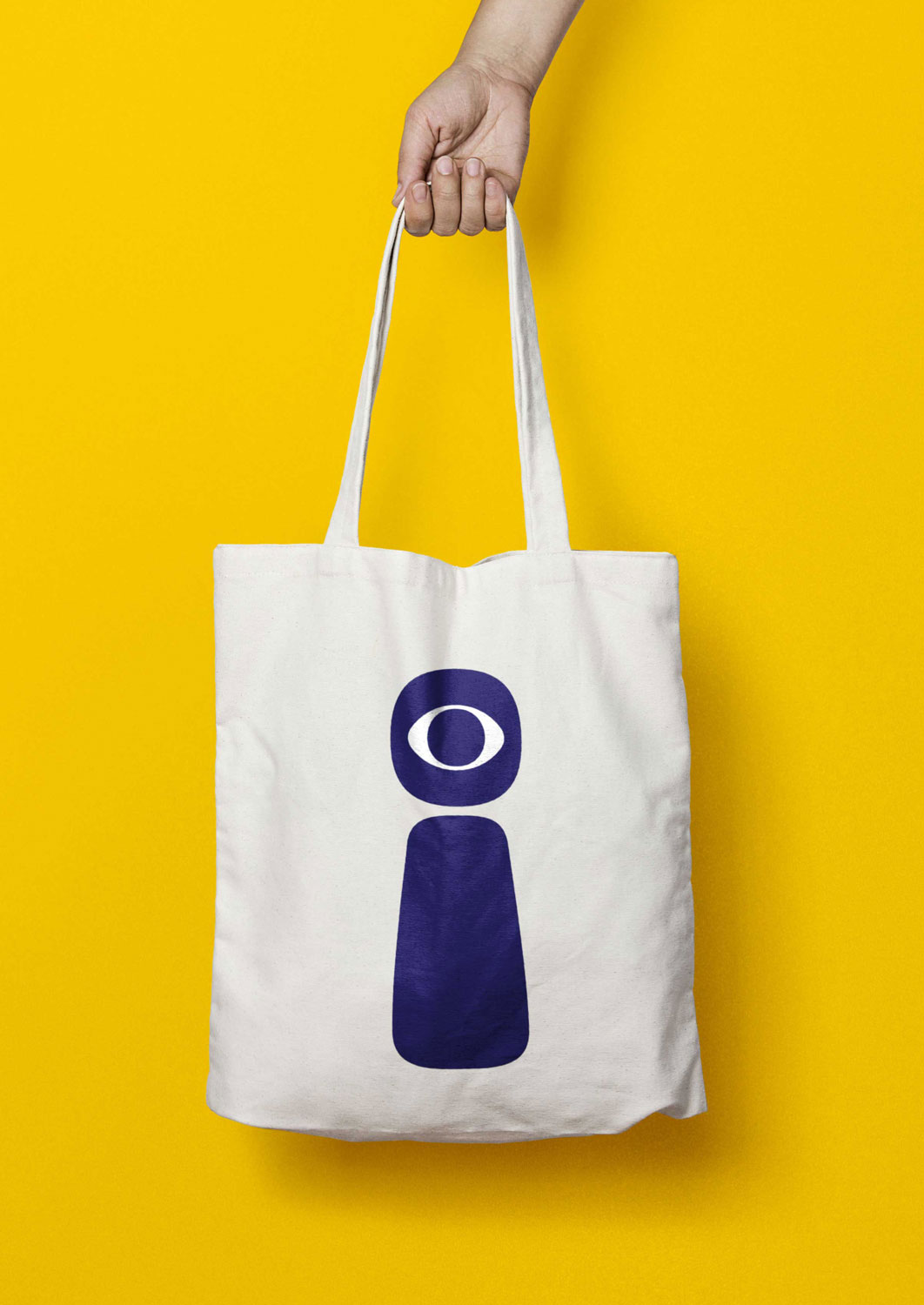 Identity design for EYEYAH! tote bag with secondary logo application.