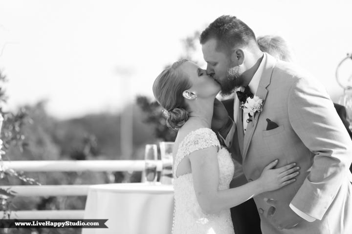 www.livehappystudio.com-orlando-wedding-photography-orlando-science-center-14-first-kiss.jpg