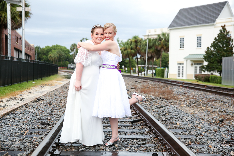 www.livehappystudio.com-wedding-photographer-orlando-fun-candid-portrait-gay-same-sex-couple-railroad-tracks-winter-park-farmers-market-49.jpg