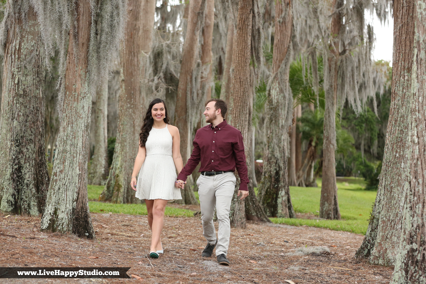 www.livehappystudio.com-cypress-grove-park-orlando-florida-engagement-photographer-candid-trees-moss-lake8.jpg