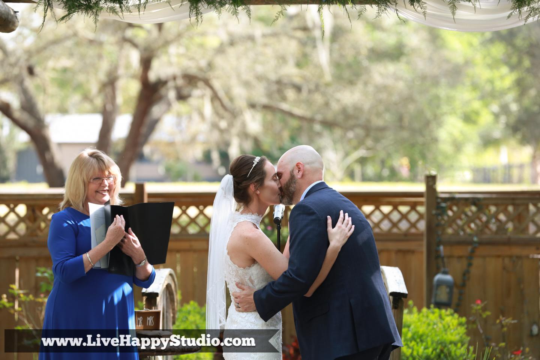 orlando wedding photography  orlando wedding photographer  harmony gardens wedding venue orlando  the kiss  first kiss as husband and wife