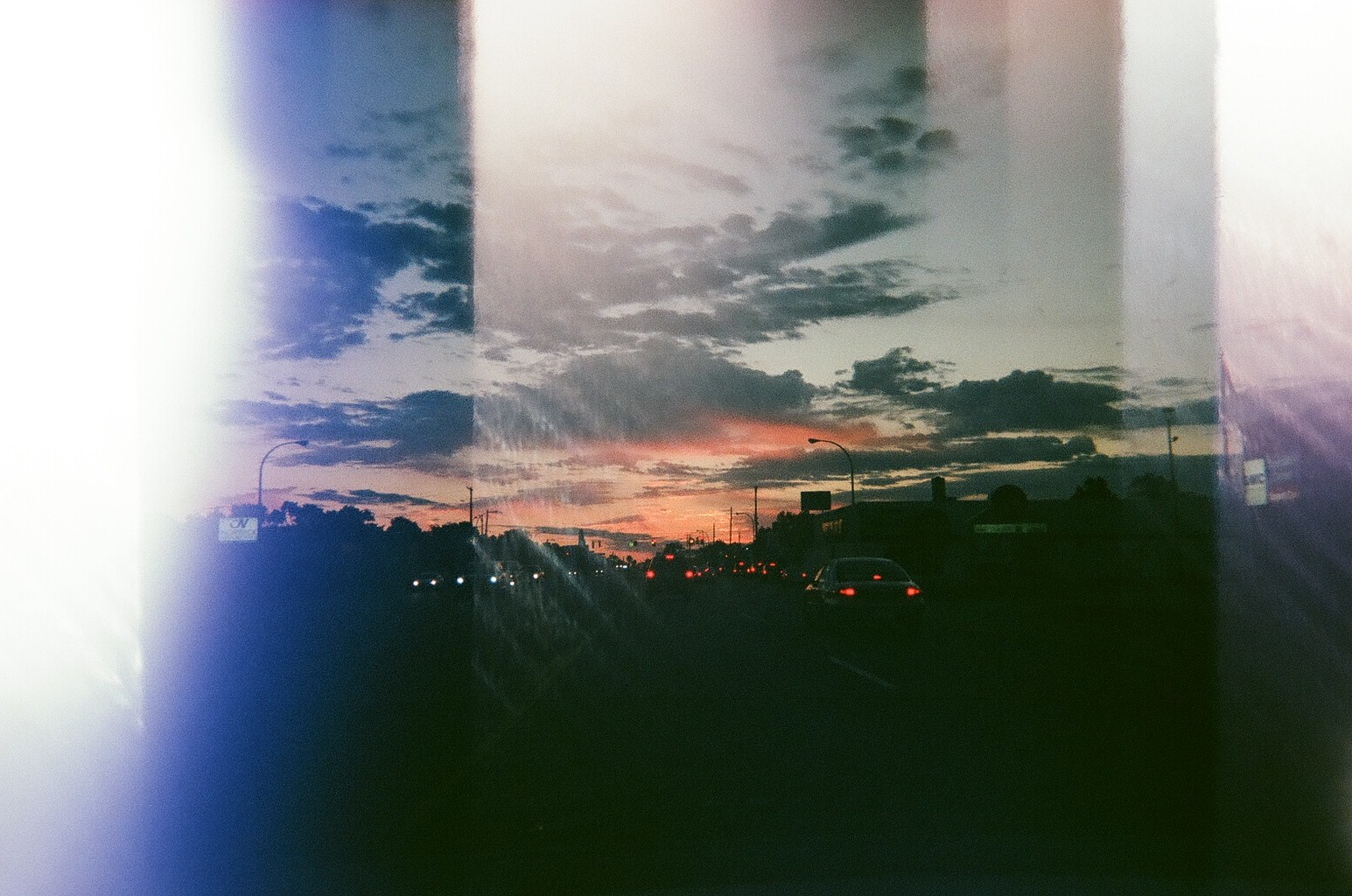 A sunset during traffic, which was taken with a single exposure. I'm not sure what happened but I really dig the effect.