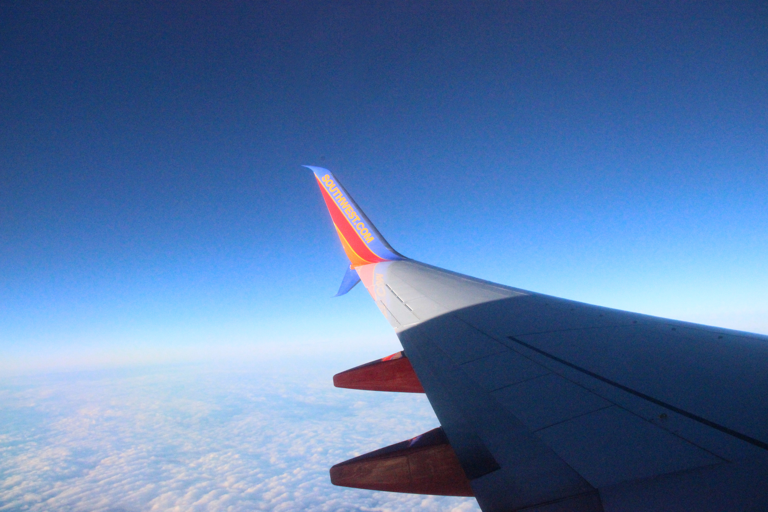 I am such a sucker for photos of airplane wings over cotton-candy clouds.