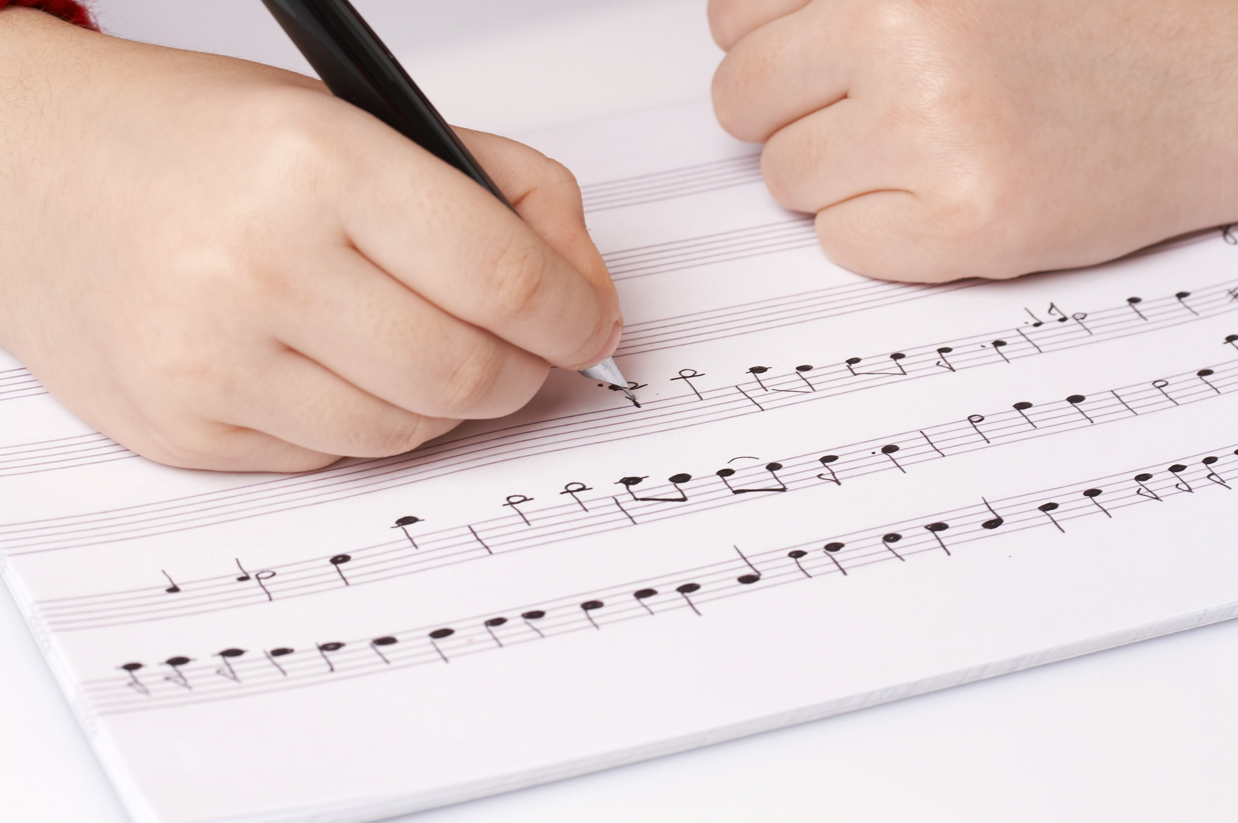 Young hands writing music.jpg