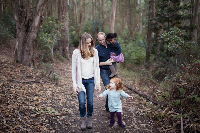 family walk through the woods