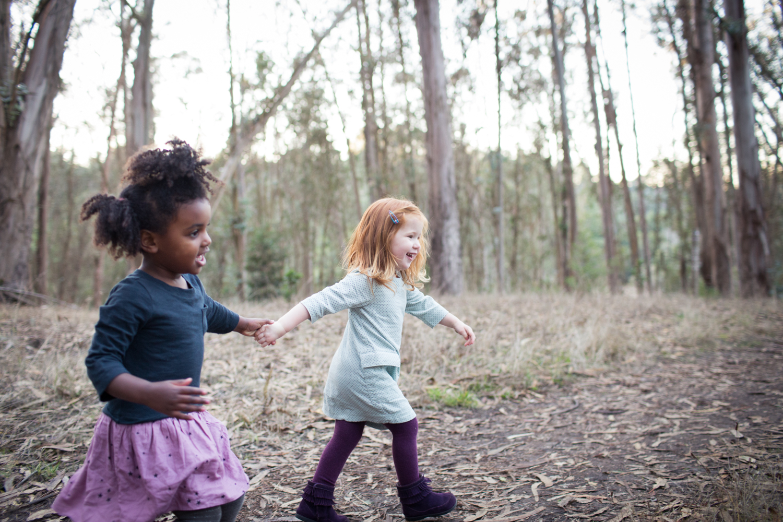 sisters in eucalyptus tree grove