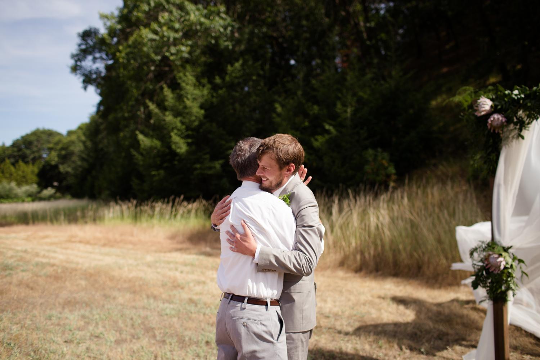hugging dad Mendocino County Wedding Photographer