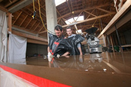 After the molds have been removed, Justin and Jerad begin the polishing process with a Diamond embedded grit pad.