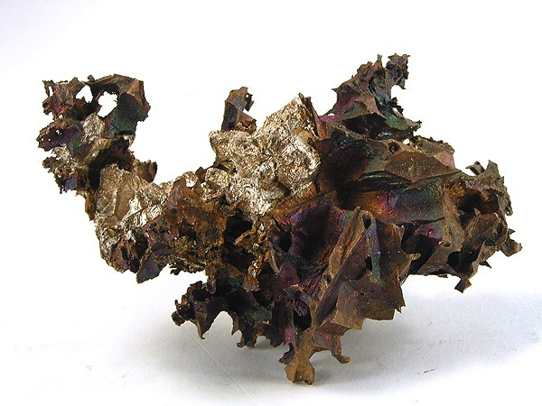 "Copper and Silver from the Adventure mine, Greenland, Ontonagon County, Michigan, USA. This specimen is not called a ""half-breed"" because the copper and silver are not densely intermixed, but intergrown. Beautiful contrast of the iridescent copper and shiny silver which has formed crude crystals instead of the usual ""lump"" upon copper most half-breeds come as."