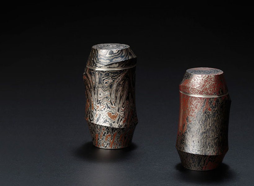 Ryuhei Sako Mokume-gane tea caddies.  http://www.sakoryuhei.com/    Mokume-gane  is a japanese technique using a variety of metals to create what is called a wood-grain effect.