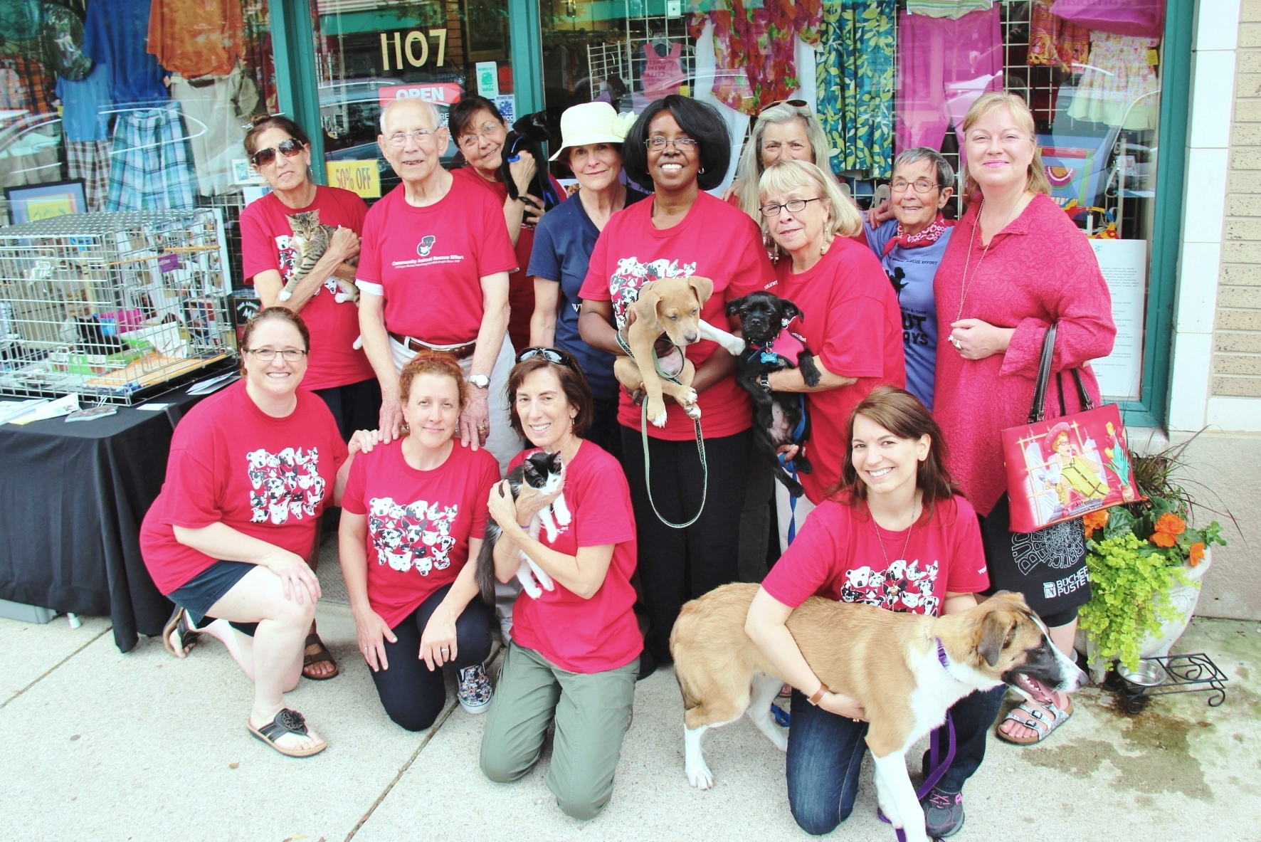 Pauline (back row, left) was an important part of the C.A.R.E. Red Shirt Crew that goes out into the community on weekends to find homes for homeless animals.