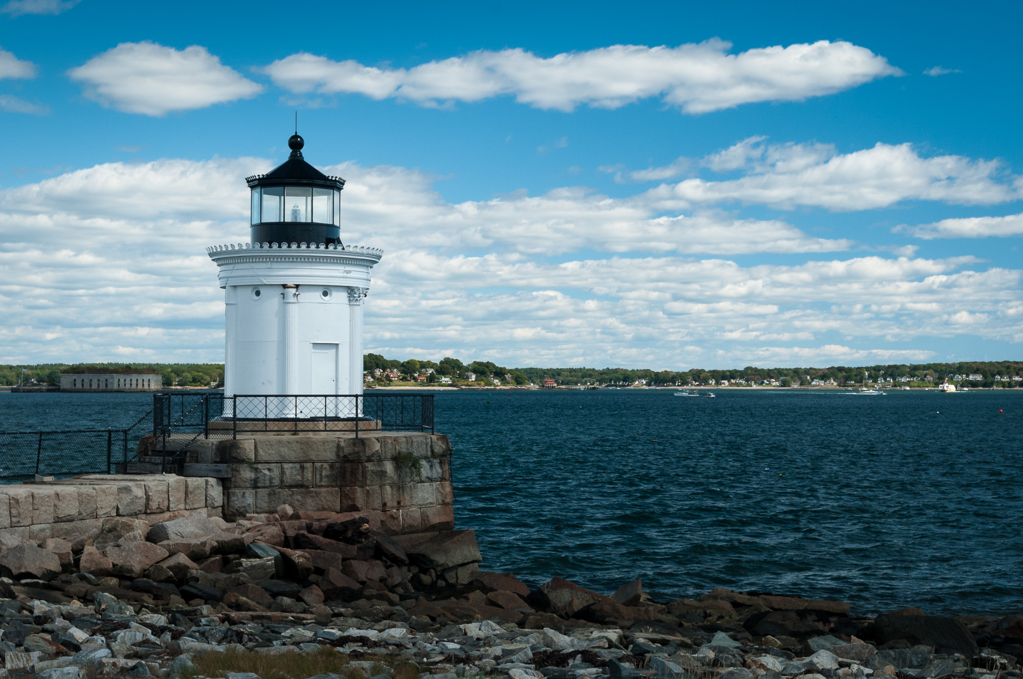 Portland Breakwater (Bug) Light, in South Portland, Maine, with distant view of Fort Gorges to the left in the bay