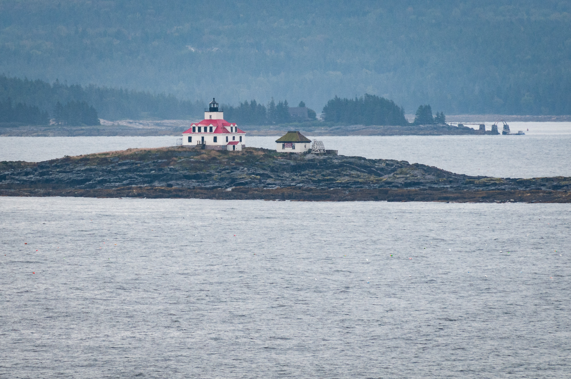 Egg Rock Light on an island in Frenchman Bay, Maine, viewed from overlook in Acadia National Park