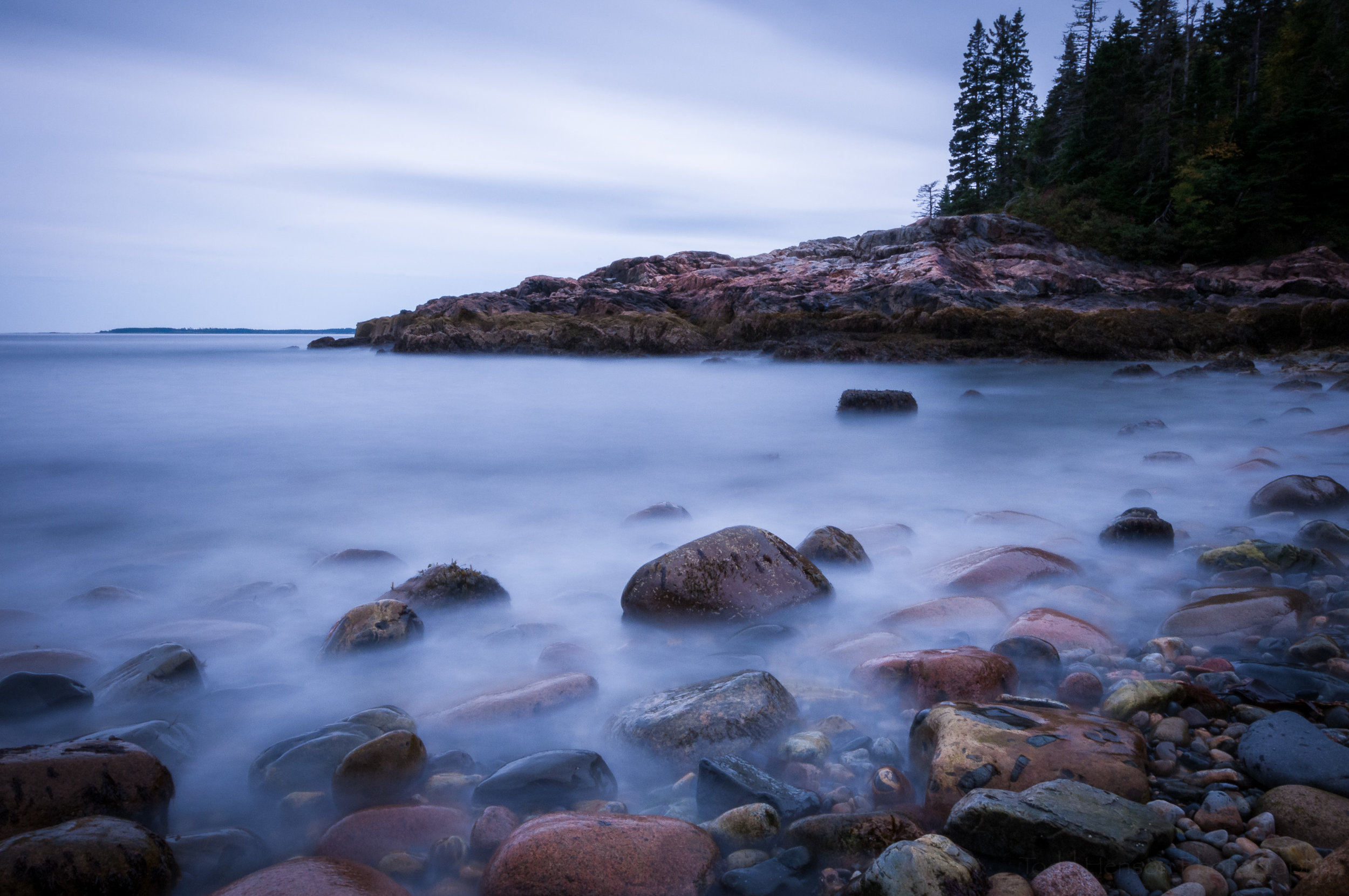 Long exposure of a rocky shoreline in Acadia National Park, Maine (cooler tones)