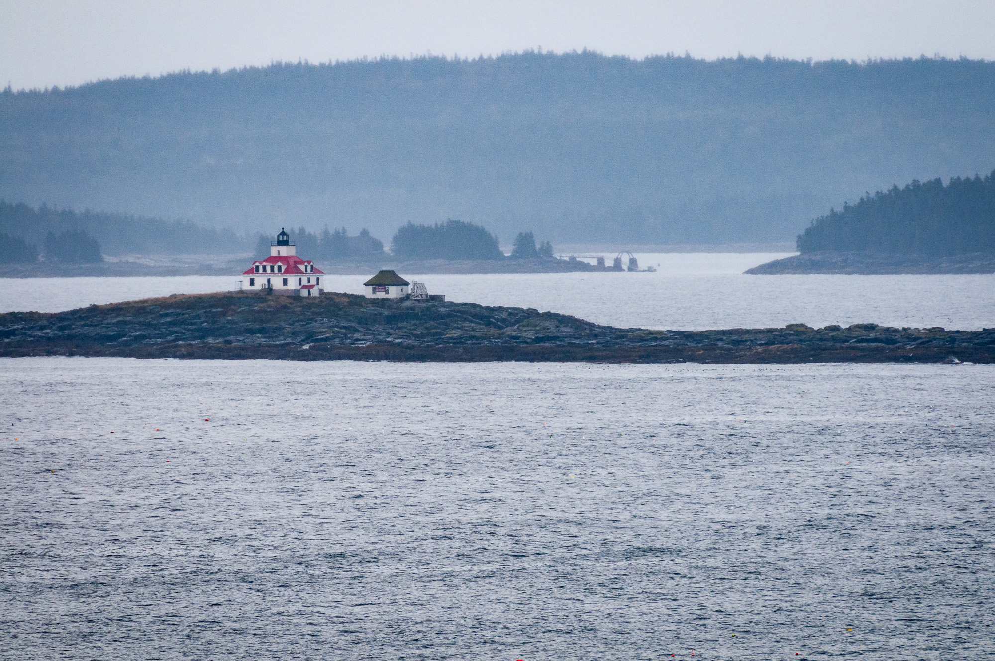 View of Egg Rock Light from parking lot of Schooner Head Overlook. This is a processed image, where I tried to cut through the mist. (400mm focal length)
