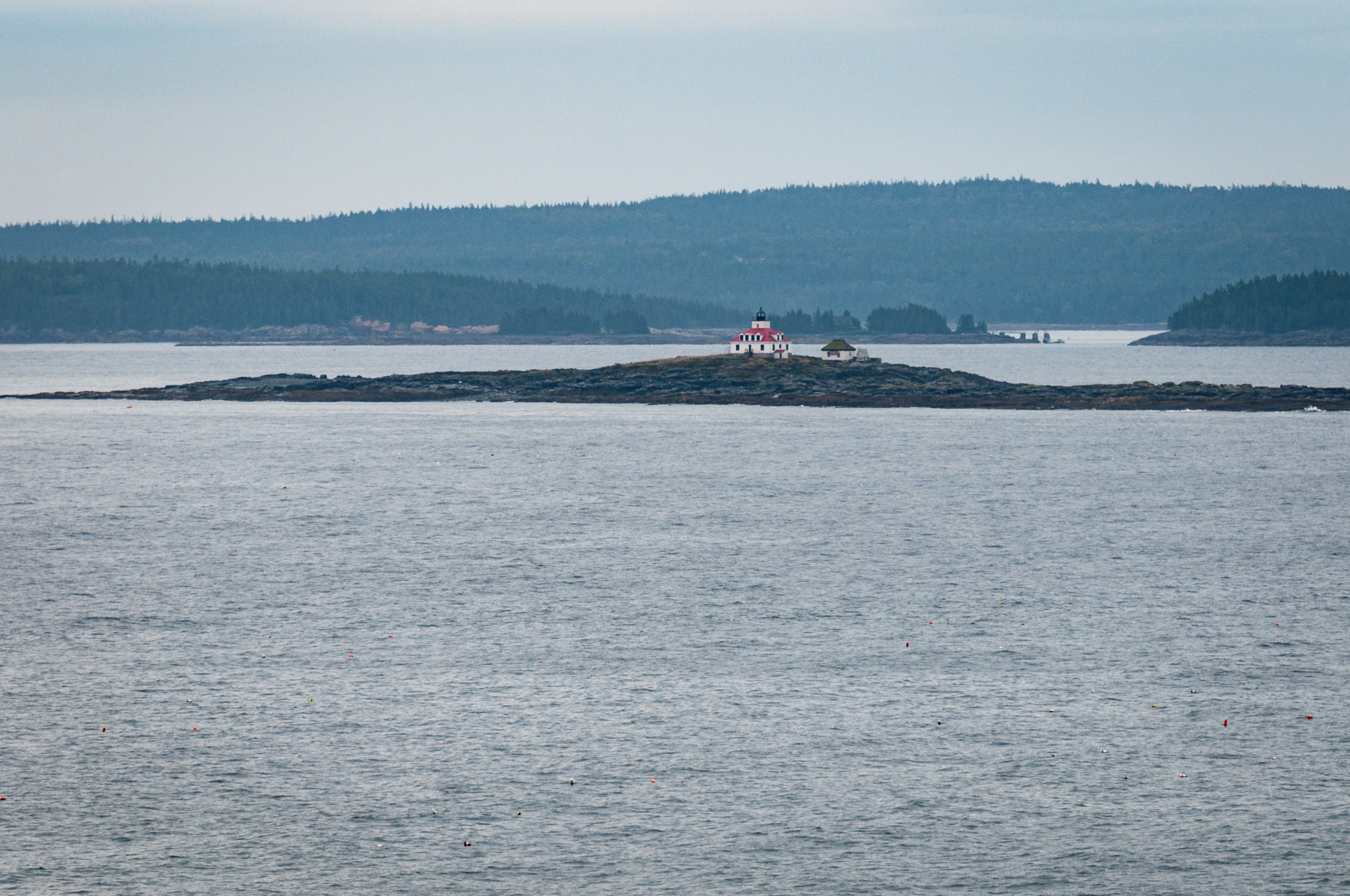 Wider view of Egg Rock Light from parking lot, processed to reduce mist. (210mm focal length)