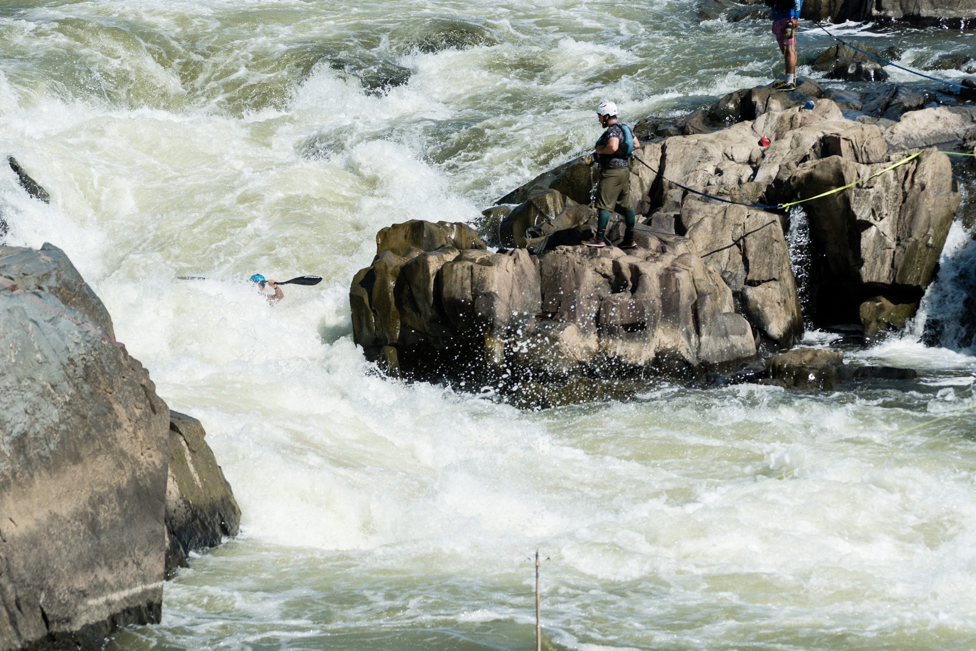 During the slalom event Jason Beakes almost disappears behind the wild water in S-Turn. The 2nd slalom gate can be seen at the bottom.