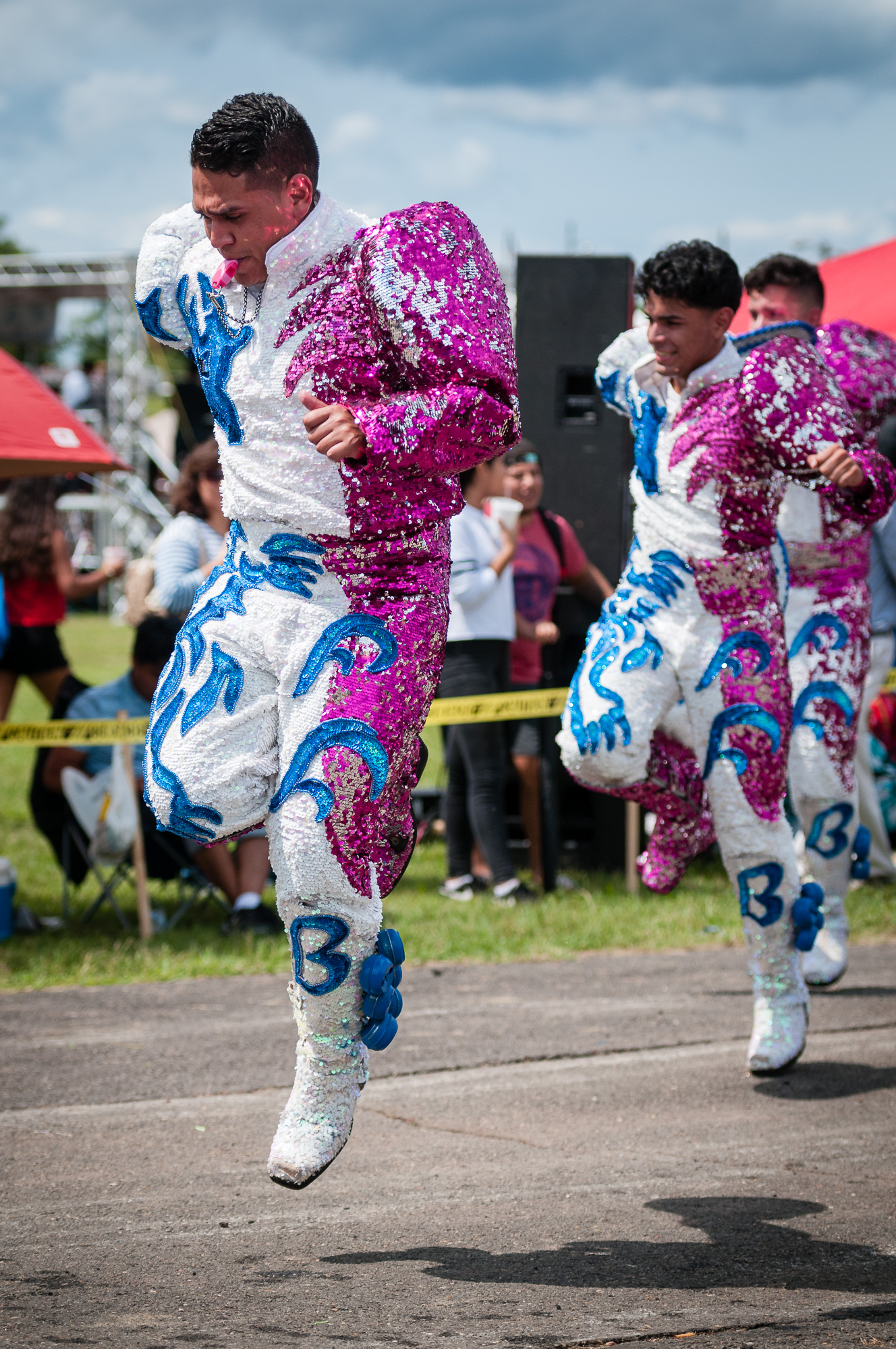 The Caporales dance performed by Fraternidad Folklorica Bolivia included energetic jumps and costumes that reflected colored light into their faces when the sun shone on them. Direct sunlight is not always a bad thing.