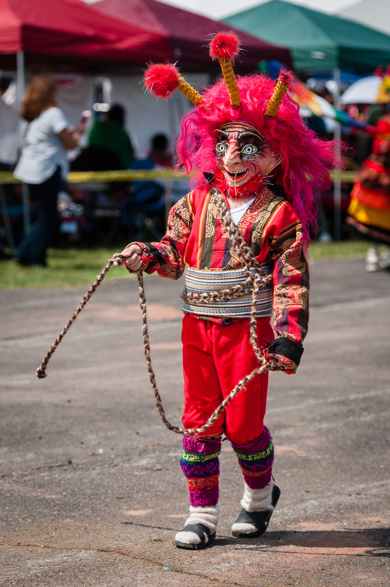 A young performer from Fundacion Socio Cultural Diablada Boliviana, fully in costume and performing during a Wititi dance.