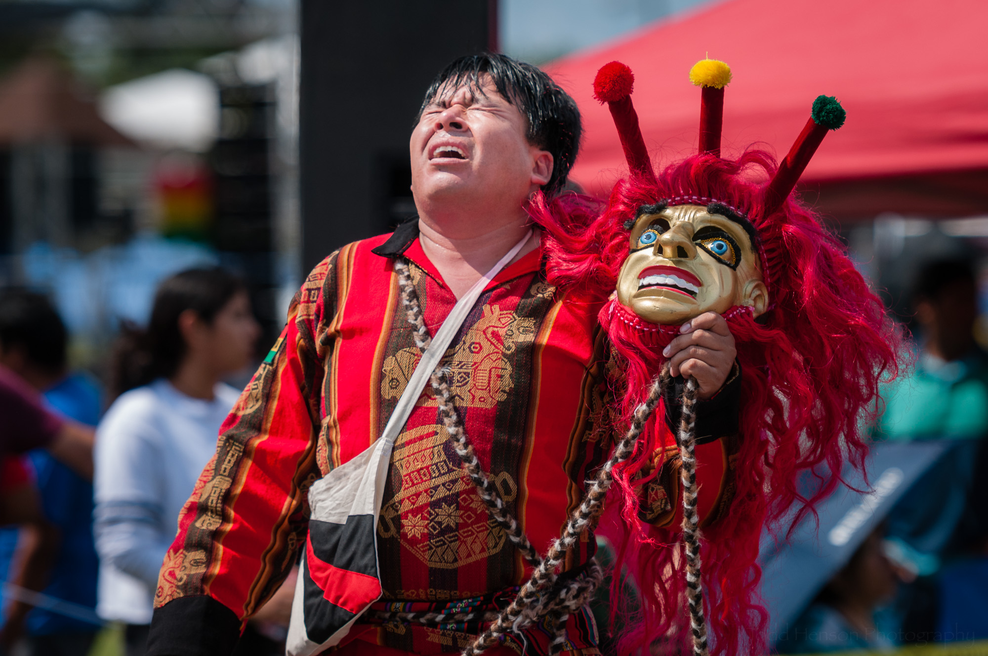 In this photo I captured the moment after the performer from Fundacion Socio Cultural Diablada Boliviana removed his mask after their final performance of a Wititi dance. You can see his exhaustion as he lifts his head towards the sun.