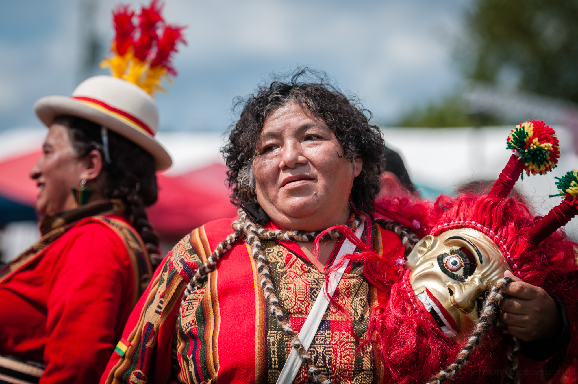 And in this photo we see another performer from Fundacion Socio Cultural Diablada Boliviana who had removed their mask after performing a Wititi dance.