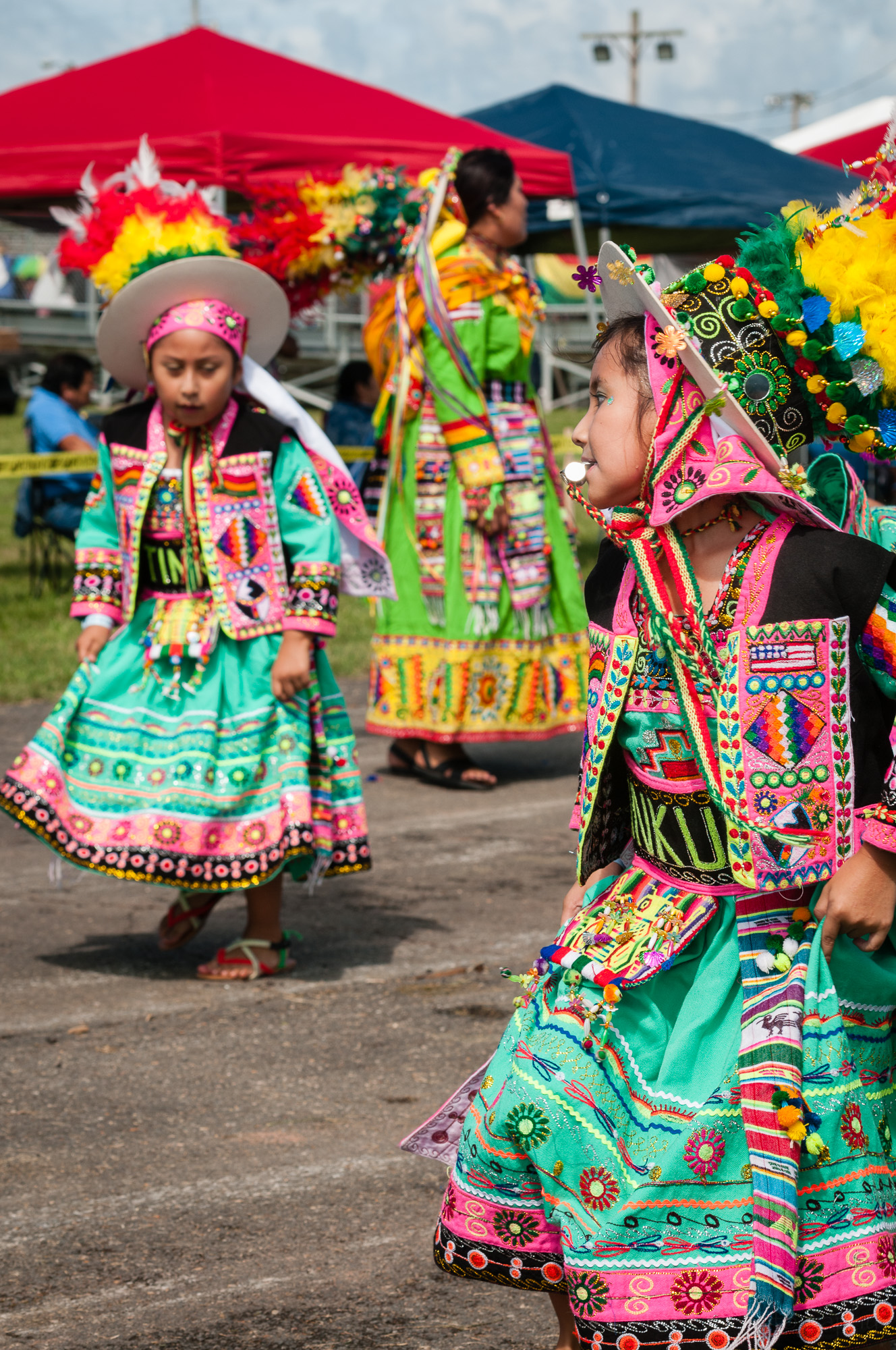 This photo captures a moment from a Tinkus dance performed by Tinkus Bolivia. I believe the girl with the whistle is leading her group within the dance. I like her pose and the positioning of the other people with the image.
