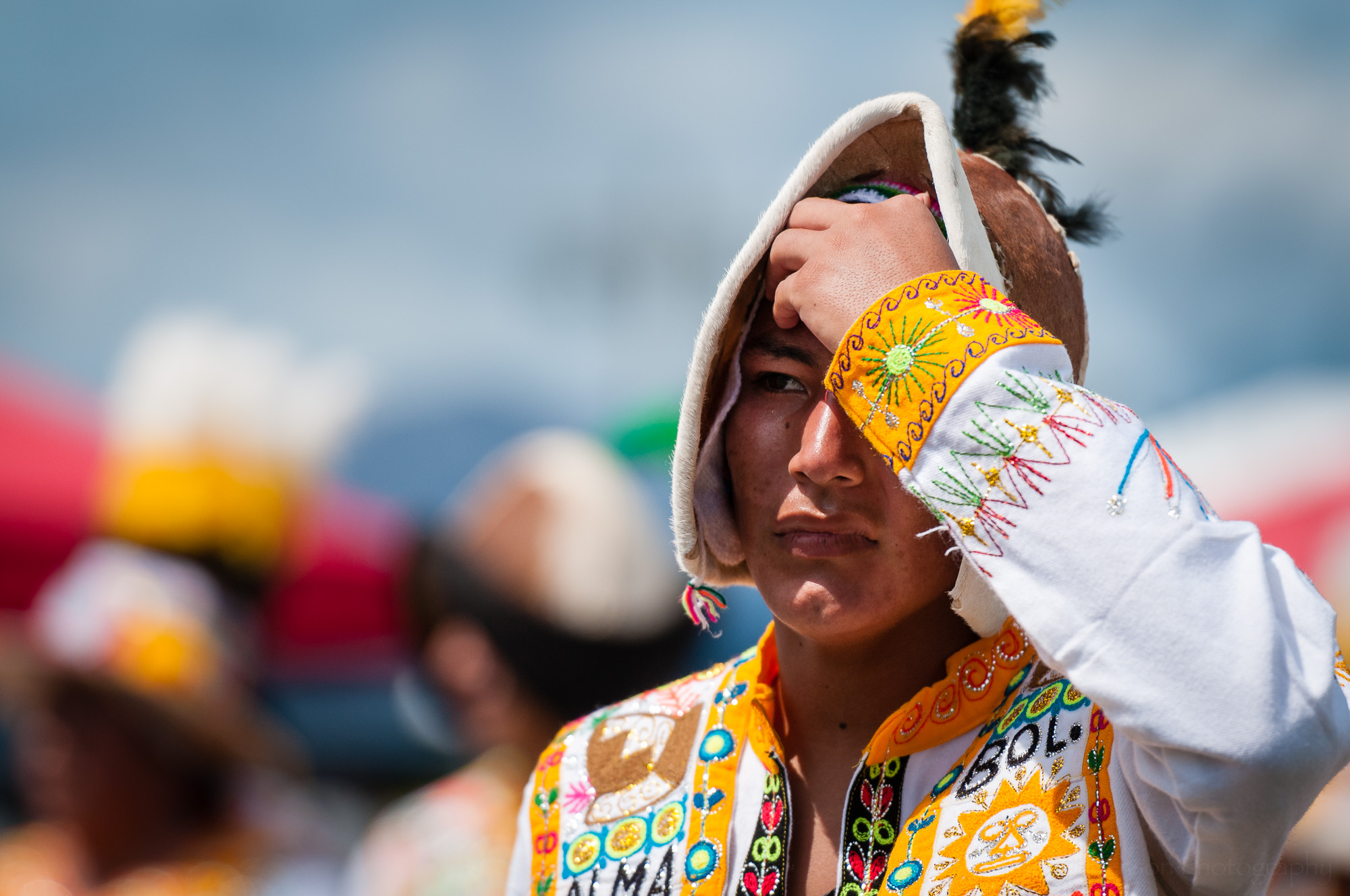 Another performer from Fraternidad Alma Boliviana after performing a Tinkus dance.