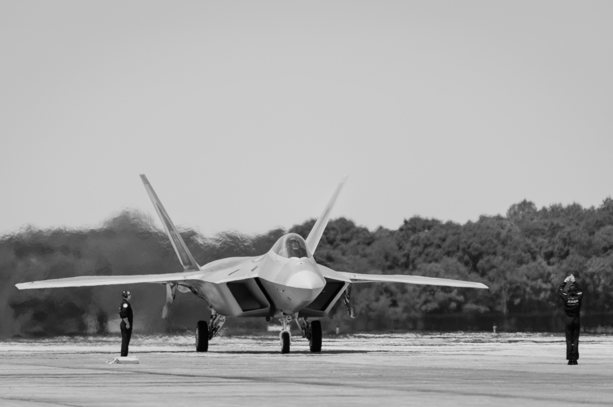 USAF F-22 Raptor taxiing on the runway.