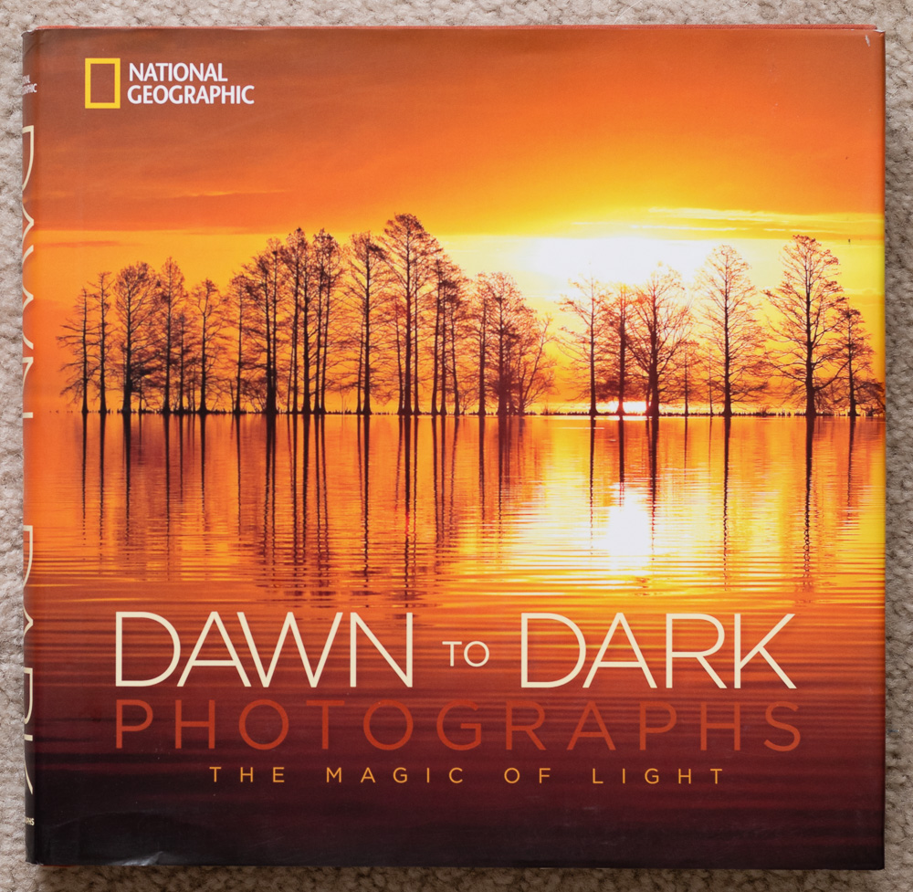 The cover of  National Geographic Dawn to Dark Photographs: The Magic of Light . Robbie George. Mattamuskeet National Wildlife Refuge, North Carolina.