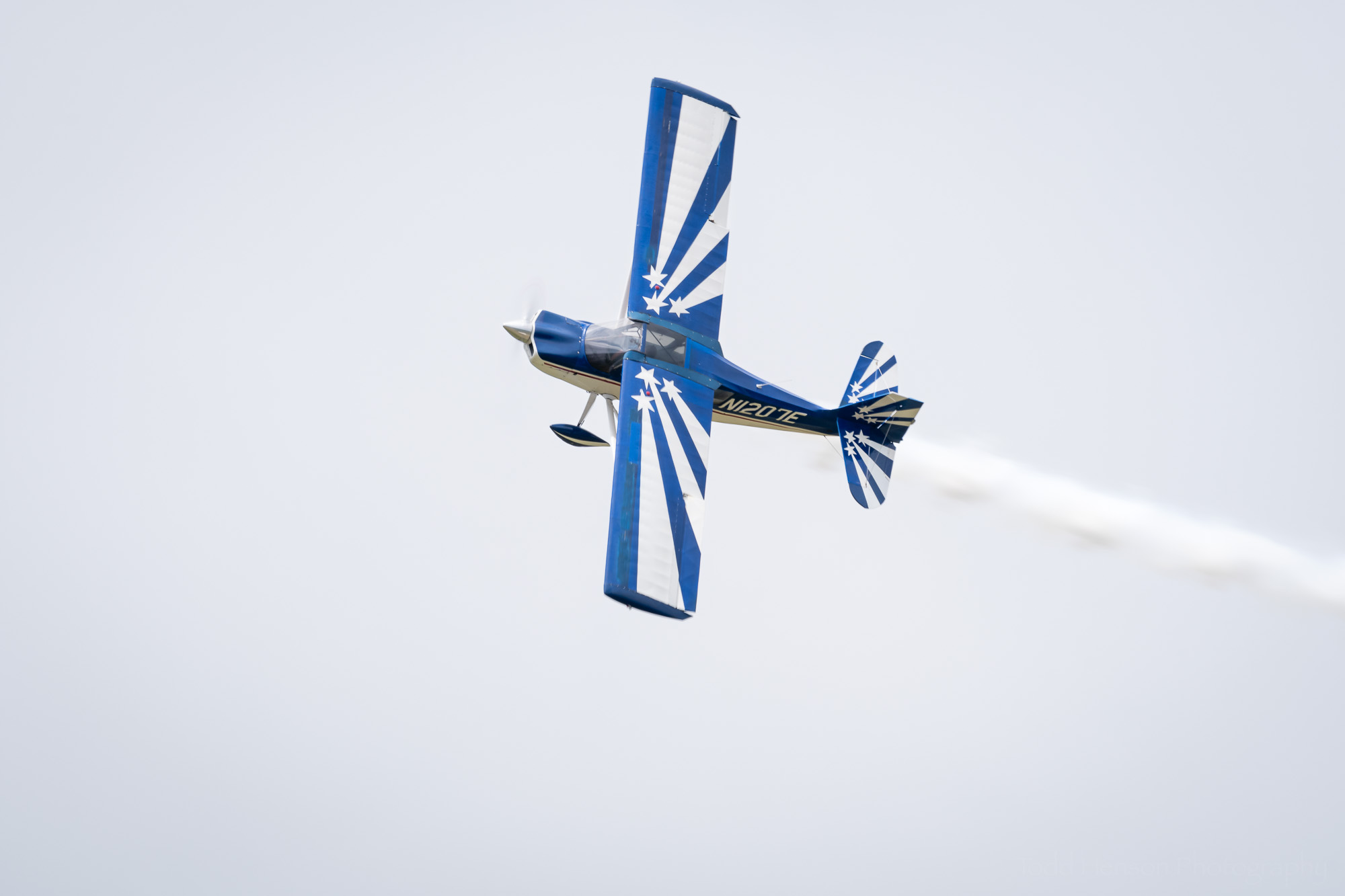 RJ Gritter flying by in his Bellanca Decathalon