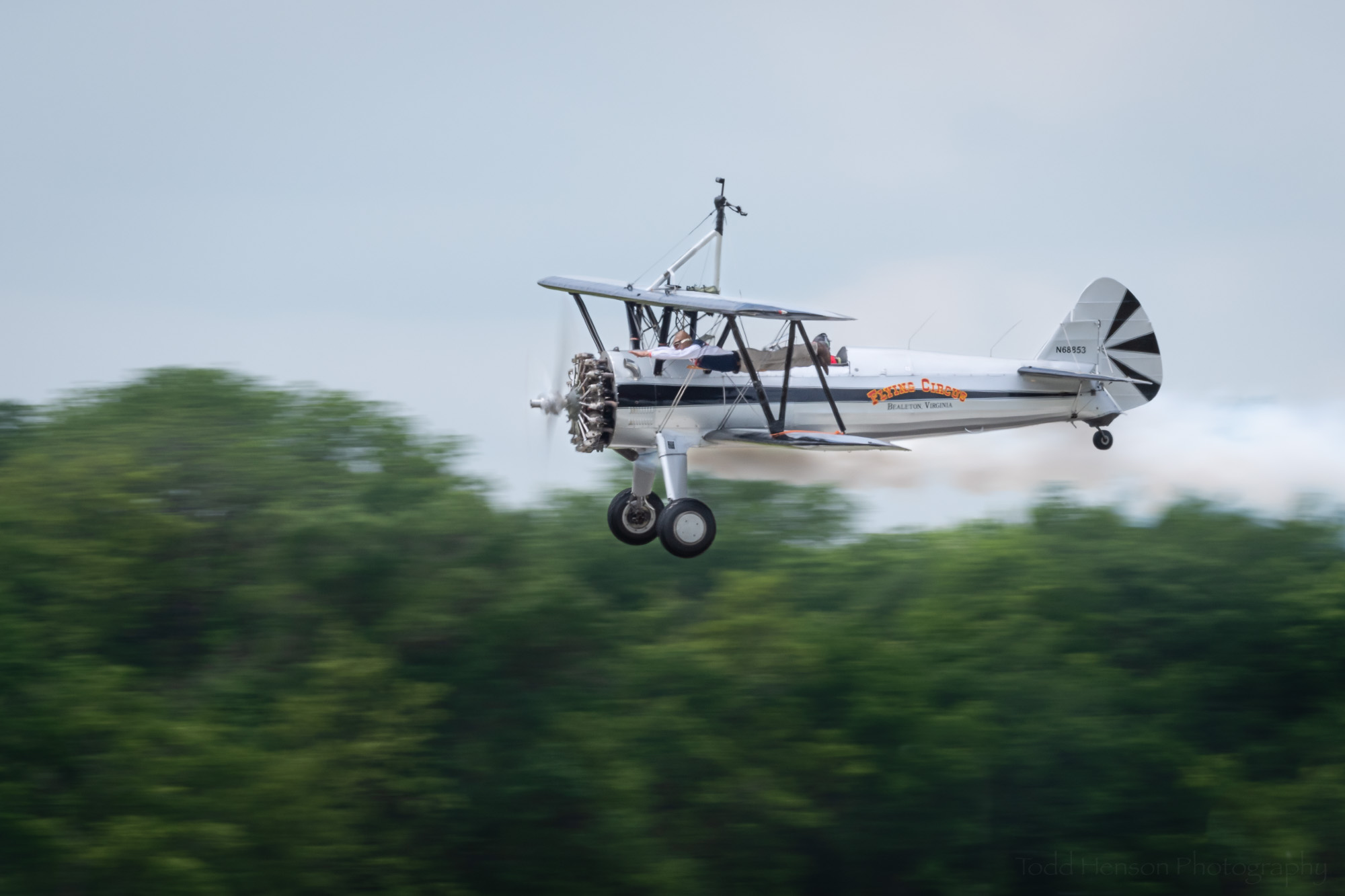 Look closely to see Joe Bender flying like Superman between the wings of the Stearman biplane, flown by Chuck Tippett, of the Bealeton Flying Circus.