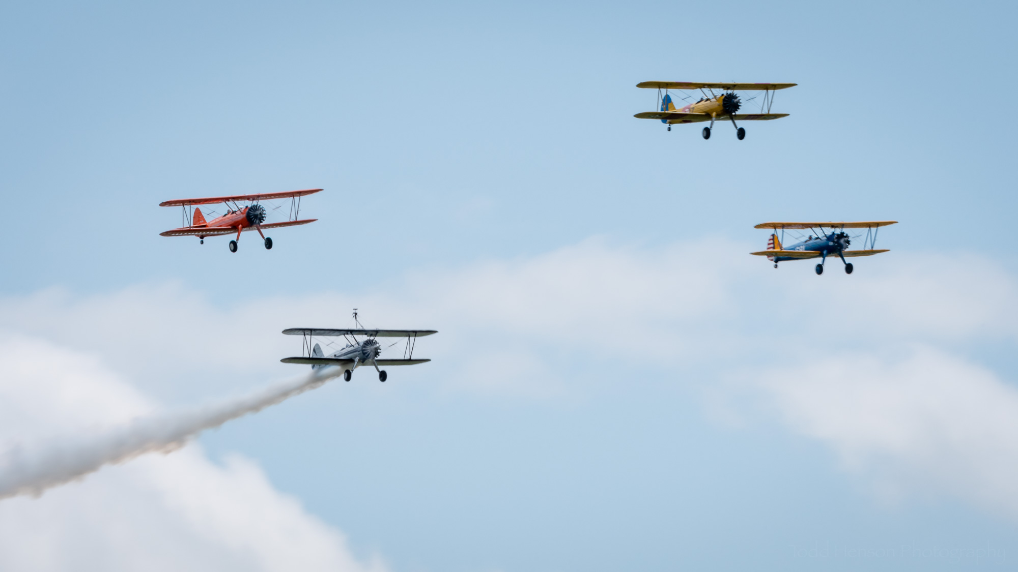 The Bealeton Flying Circus Stearman biplans flying in formation.
