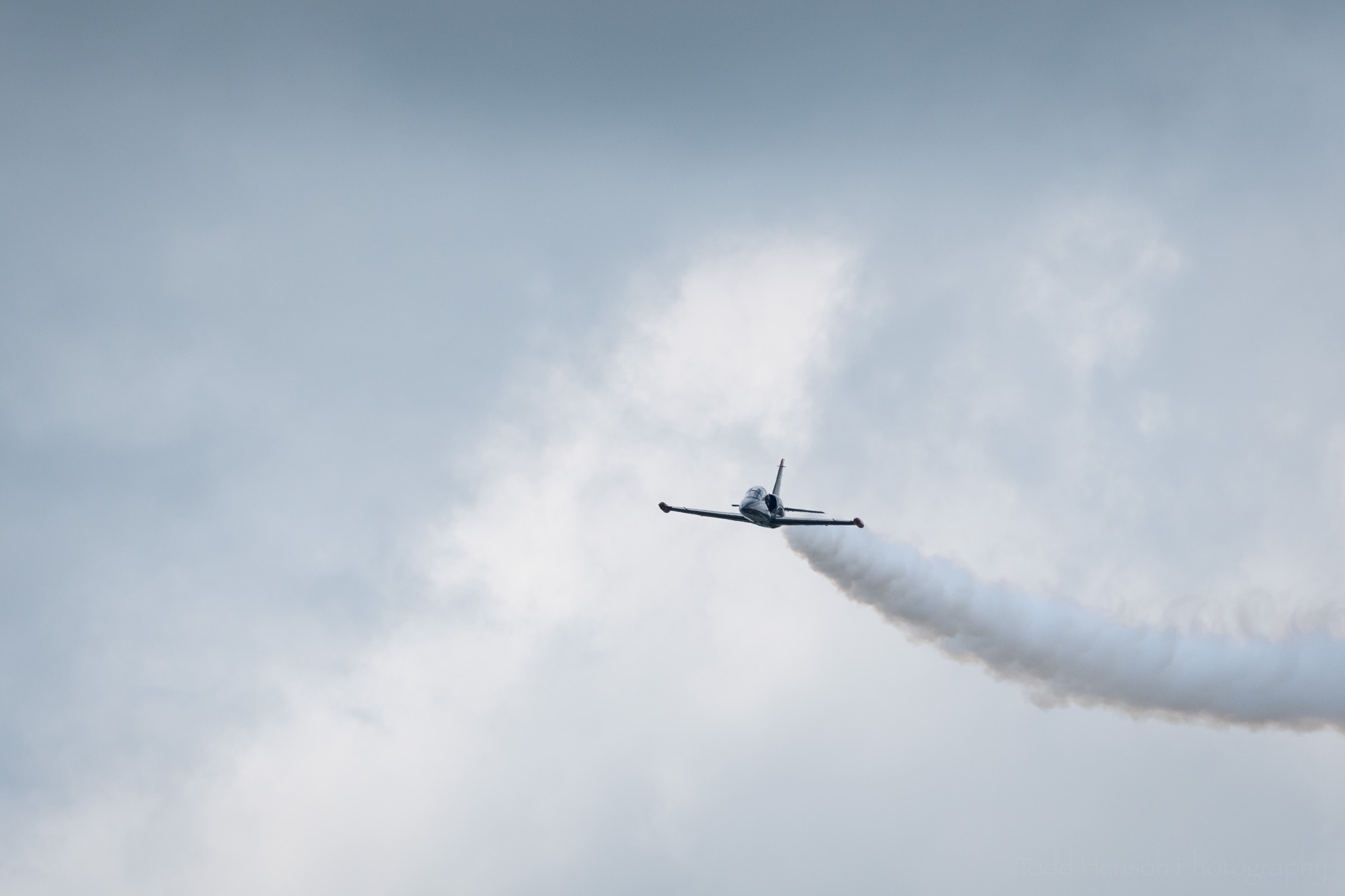 One of the Warrior Flight Team L-39's coming in from a distance, trailing smoke.