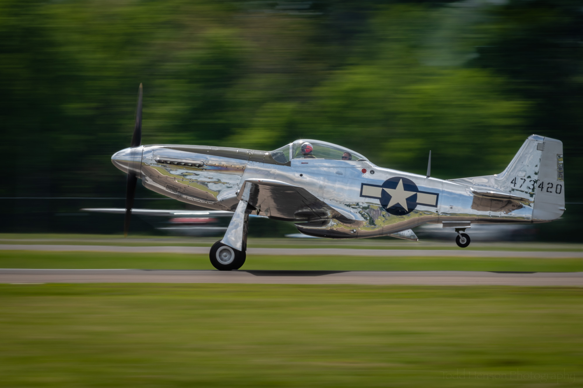 P-51 Mustang taking off. The rear tire has already left the runway.