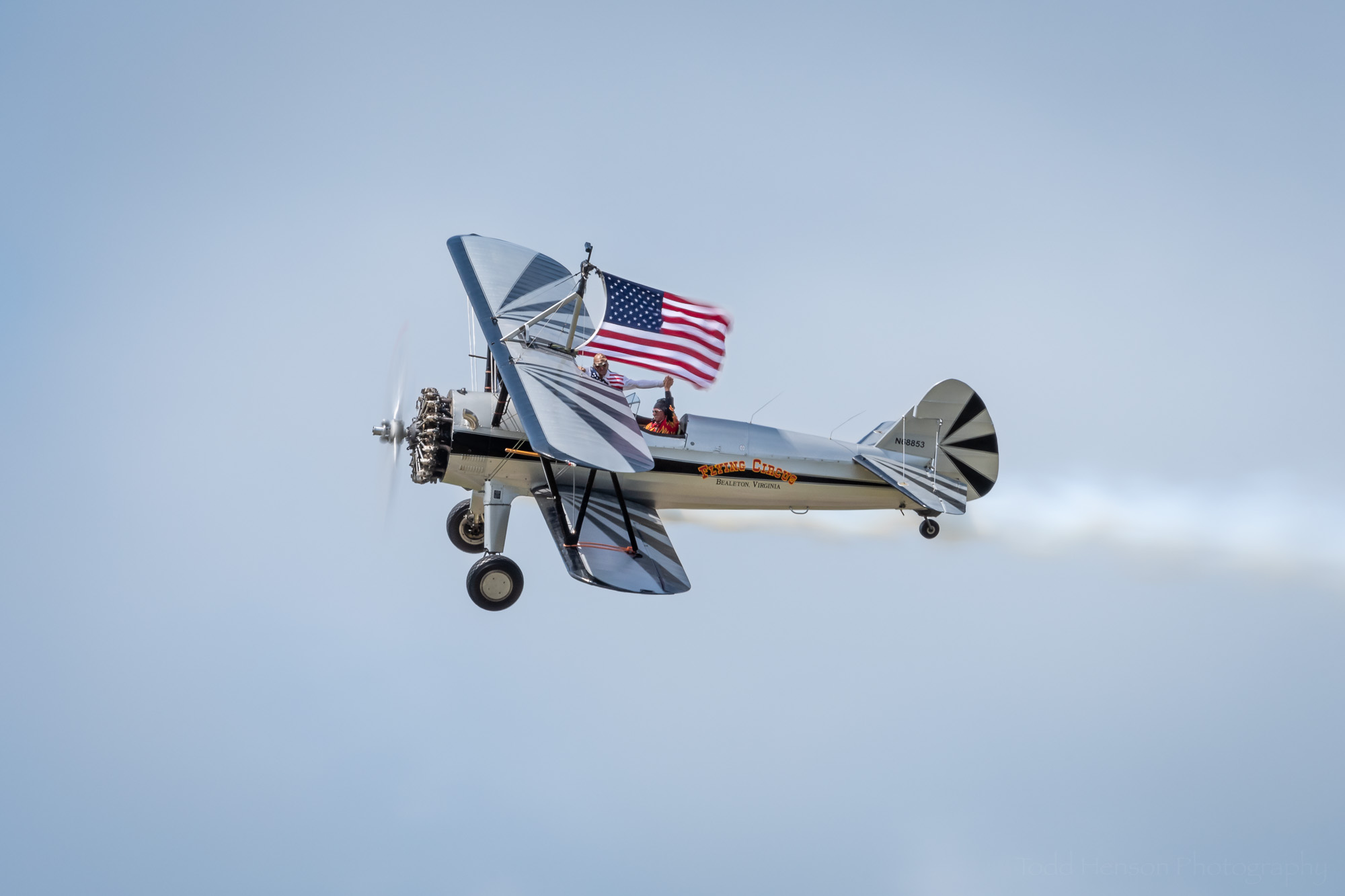 The Flying Circus of Bealeton, Virginia, in the 2019 Manassas Airshow, displaying the American flag.